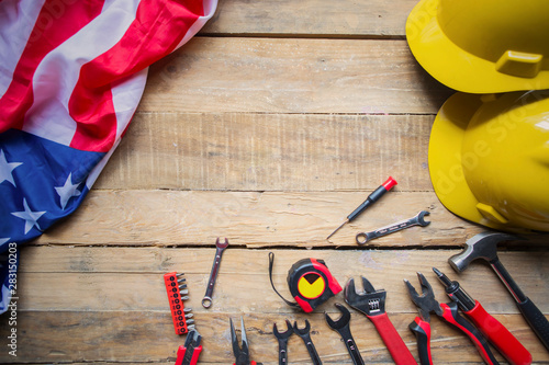 Photo Stands Asia Country Two helmets with tools and American flag on table