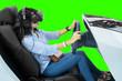 Leinwandbild Motiv Woman plays a racing game with a VR glasses