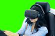 Leinwandbild Motiv Woman uses a VR glasses to play a racing game