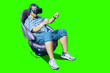 Leinwandbild Motiv Young man playing a racing game with a VR glasses