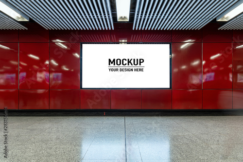 Obraz Blank billboard located in underground hall or subway for advertising, mockup concept, Low light speed shutter - fototapety do salonu