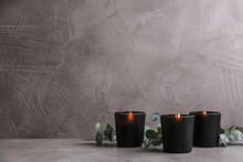 Burning Candles And Green Branches On Table, Space For Text