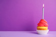 canvas print picture - Birthday cupcake with candle on violet background, space for text