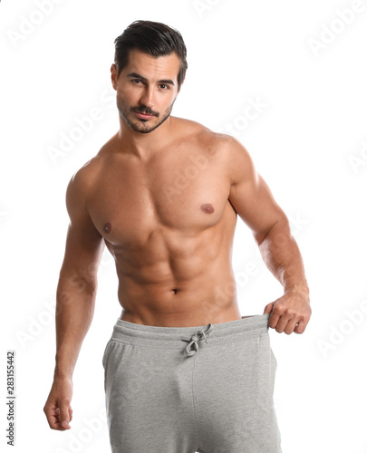 Fotomural  Young man with slim body on white background