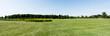 Leinwandbild Motiv panoramic shot of blue sky in green park with trees in summertime