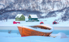 Beautiful Winter Landscape With Snow Covered Green House - Red Wooden Boathouse Covered With Layers Of Snow - Tromso, Norway