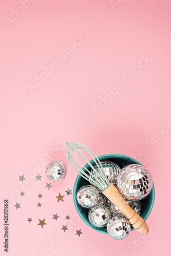 Flat lay with disco balls in the bowl with whisk. Party, fun, celebration planning - 283176661