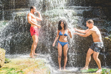 Happy Friends Having Fun Under Waterfalls In Summer Vacation Outdoor - Young People Playing With Water Inside A River - Travel Lifestyle, Youth And Friendship Concept - Focus On Afro Girl Face