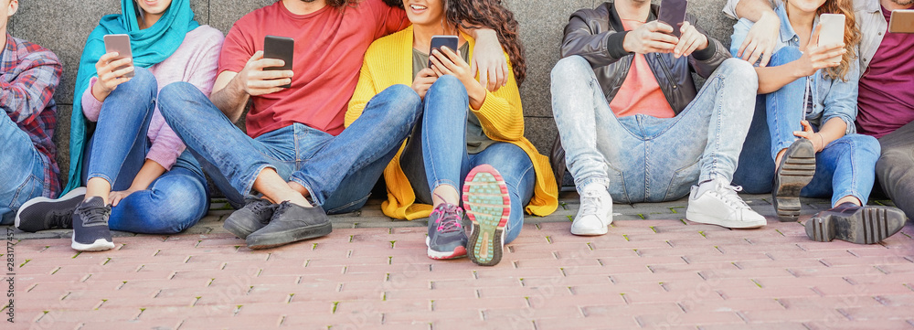 Fototapeta Group of friends using smart mobile phones - Teenagers addiction to new technology trends - Concept of youth, tech, social and friendship - Main focus on hands