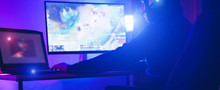 Young Streamer Gamer Playing At Strategy Game In Broadcast Browser - Male Guy Having Fun Gaming And Streaming Online - New Technology Game Trends And Entertainment Concept - Soft Focus On His Hand