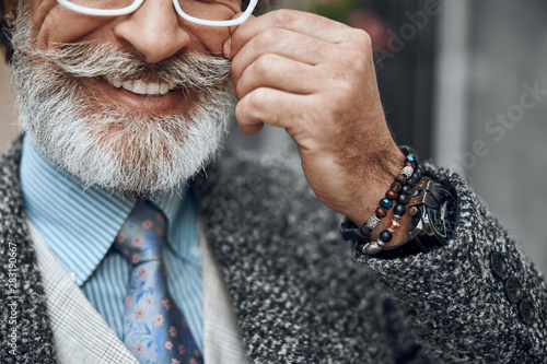 Poster Ouest sauvage Happy man smiling and touching moustache stock photo