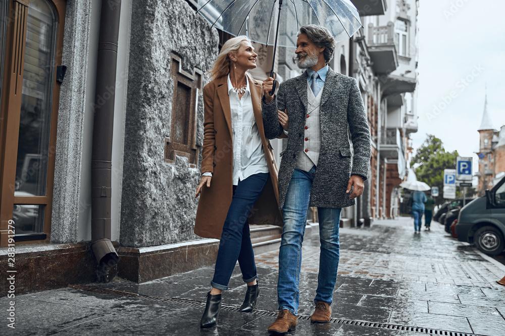 Fototapeta Romantic walk in the rain stock photo