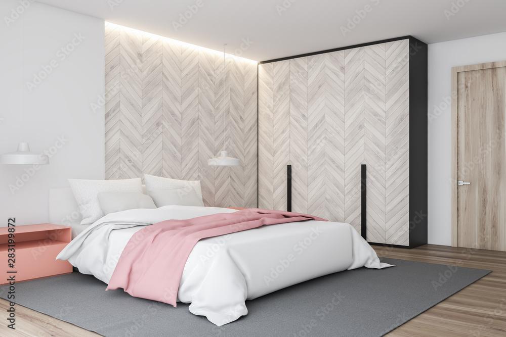Fototapeta White and wooden master bedroom corner