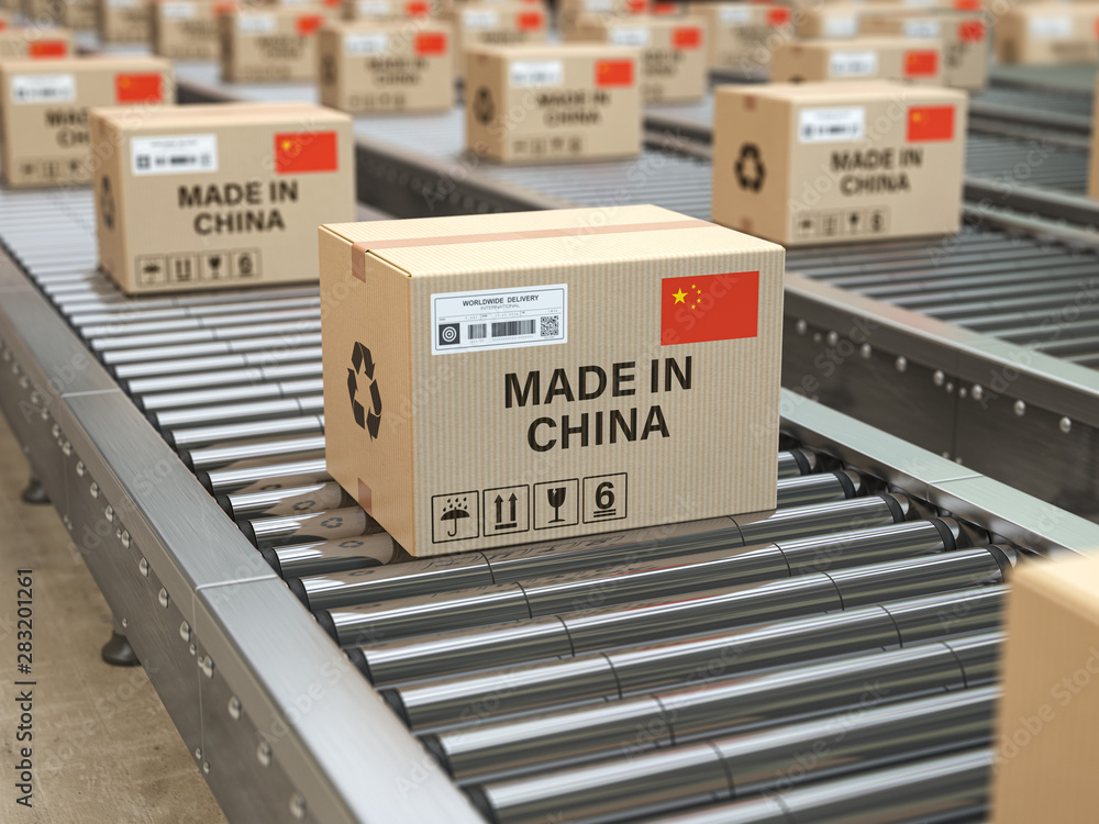 Fototapeta Made in China. Cardboard boxes with text made in China and chinese flag on the roller conveyor.