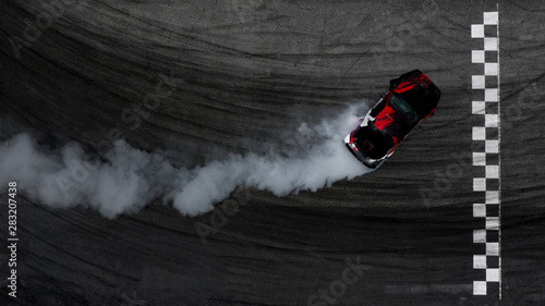Vászonkép Aerial top view car drifting on asphalt race track with start and finish line and lots of smoke from burning tires, Auto or automobile background concept