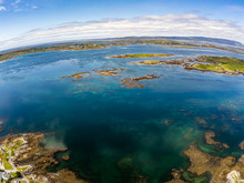 Aerial View Of Bay With Low Tide, Seaweeds And Mountains In Carraroe