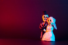 Day Of The Dead Skulls Of A Newlywed Couple On A Black Background On The Left