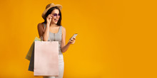 Gladful Lady Holding Shopping Bags And Using Phone, Panorama