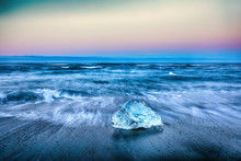 Incredible Pieces Of The Iceberg Sparkle On Famous Diamond Beach At  Jokulsarlon Lagoon During Sunset