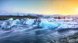 Beautifull landscape with floating icebergs in Jokulsarlon glacier lagoon at sunset