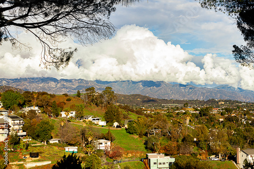 hillside homes mountain range with huge cumulus nimbus clouds Canvas Print