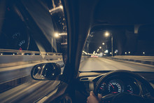 Driving A Car At Night On The Way
