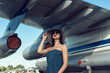 Brunette in a dress at the old airport