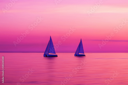 Two yachts in amazing purple colors of sunset sky, blurred sea water