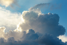 Large Cumulus, Nimbus Clouds With Silver Lining, In Blue, And White