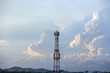 Silhouette signal antenna tower at sunrise sky