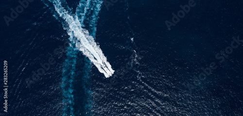 Fotografie, Obraz  View from above, stunning aerial view of a luxury yacht sailing on a blue sea