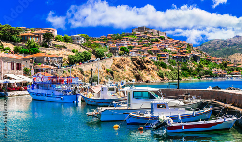 Best of Greece - scenic Lesvos island. Molyvos (Mythimna) town. view of port and medieval castle on hill top