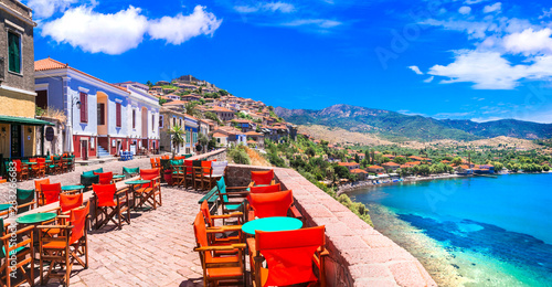 Traditional colorful Greece series - street bars and taverns of Molivos town, Lesvos island
