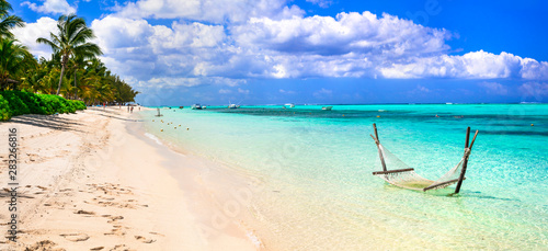 Mauritius island holidays. Beautiful beach scene with hammock
