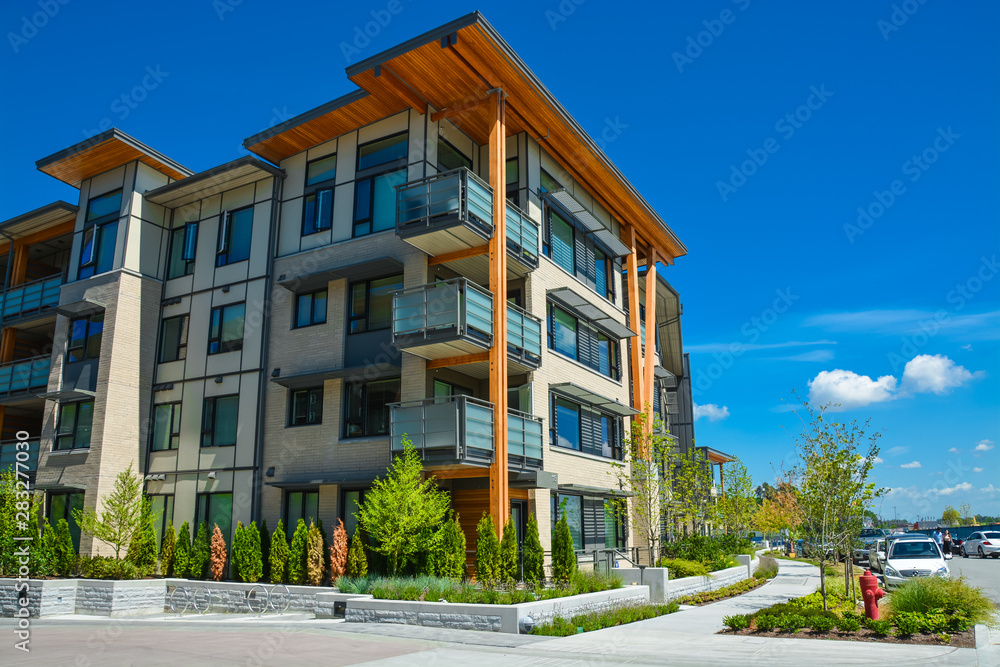 Fototapety, obrazy: Brand new apartment building on sunny day in British Columbia, Canada.