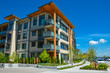 Leinwanddruck Bild - Brand new apartment building on sunny day in British Columbia, Canada.
