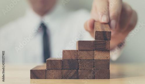 Carta da parati  Hand arranging wood block stacking as step stair