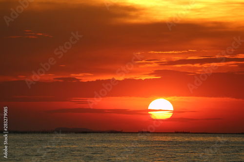 Fototapeta sunset on red yellow sky back soft evening cloud over horizon sea obraz