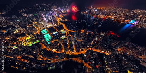 Stampa su Tela  Panorama aerial view of Hong Kong City at night with fireworks