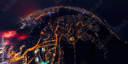 Fotografia  Panorama aerial view of Hong Kong City at night with fireworks