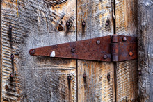 Rusty Hinge On Wooden Gate