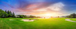 Green grass and woods on a golf field