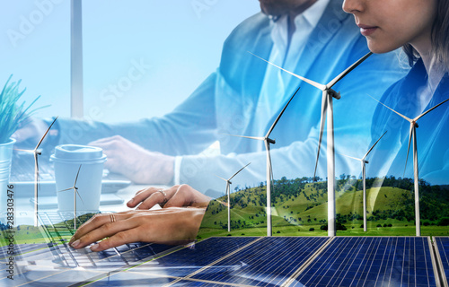 Double exposure graphic of business people working over wind turbine farm and green renewable energy worker interface Canvas