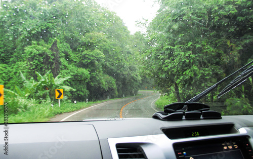 Montage in der Fensternische Khaki Car and road landscape while raining background