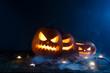 Leinwandbild Motiv Halloween pumpkin lantern in mist