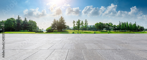 Obraz Empty square floor and green woods natural scenery in city park - fototapety do salonu