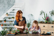 canvas print picture Home gardening business. Mother and daughter planting and growing succulents for sale.
