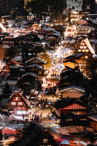 Fotografie, Tablou  Snow falling at light Up Festival