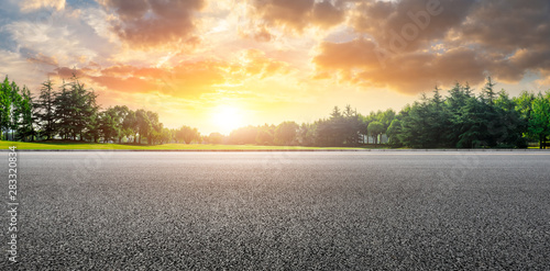 Fotobehang Cappuccino Country road and green woods nature landscape at sunset