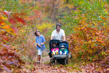 Family Hiking With Stroller In...